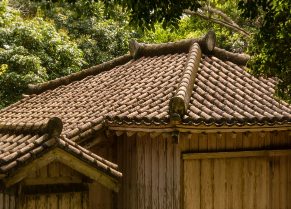Beautiful roof tiles on the guard house (BANYA) at the entrance to the Shikinaen Royal Garden, Naha, Okinawa, Japan