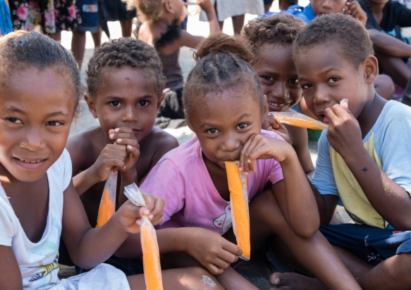 "Many of the local children got a special treat when we brought our cooler over with ice and water – ""popsicle"" flavored sticks, Santa Ana, Solomon Islands"