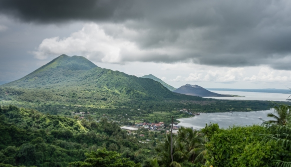 Mt. Vulcan and Mt. Tavurvur, photographed from the grounds of the Rabaul Seismic Observatory, Rabaul, Papua New Guinea