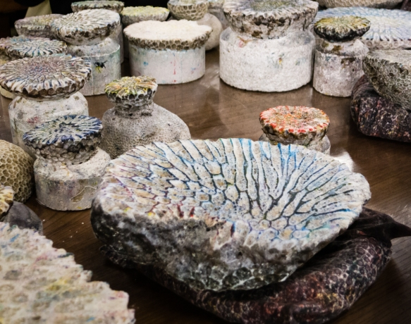 "Natural fossilized corals are filed flat to become ""molds"" for ""printing"" textiles by rubbing the fabric with sponges filled with colored dyes, Naha, Okinawa, Japan"