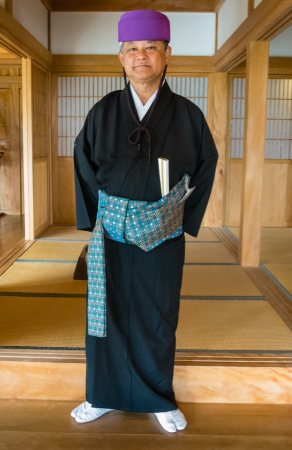 One of the interior guards in traditional dress in the reconstructed Seiden (the main King_s residence), Ryukyu Castle, Naha, Okinawa, Japan