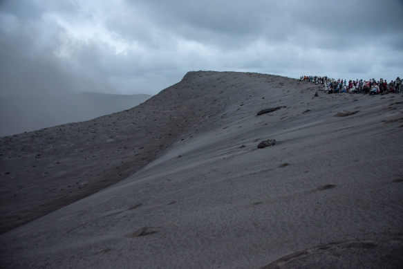 our-group-assembled-on-the-crater-rim-right-side-of-photograph-which-was-as-close-to-the-volcano-some-smoke-is-billowing-out-on-the-left-as-visitors-are-allowed-mount-yasur-volcano-tanna-islan