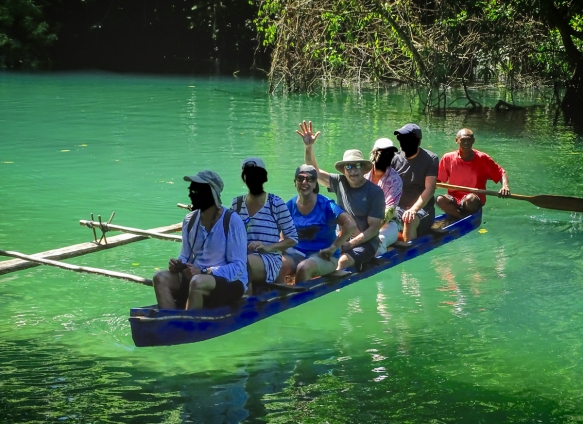 our-intrepid-explorer-and-your-blogger-in-a-traditional-island-outrigger-canoe-on-the-riri-riri-river-heading-to-santos-largest-blue-hole-luganville-espiritu-santo-vanuatu