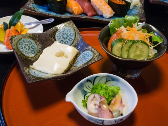 Our starters included cuddlefish stuffed with its roe, soft tofu and a Japanese salad at the Sushi restaurant in Arita, Kyushu, Japan; the fruit was a light dessert