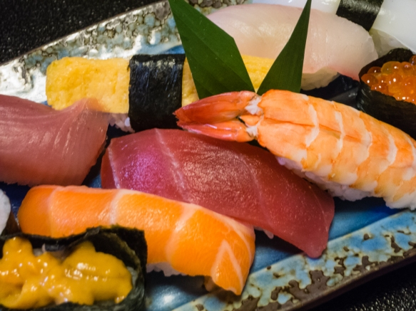Shown here are the uni (a sea urchin's gonads), sake (salmon), fatty tuna, maguro (tuna), cooked egg, prawn, himmachi and roe pieces of sushi for our lunch at the Sushi restaurant in Ari