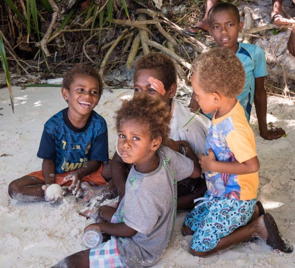 The beach was full of kids and adults extending a warm welcome to their home island, Loh Island, Torres Islands, Vanuatu