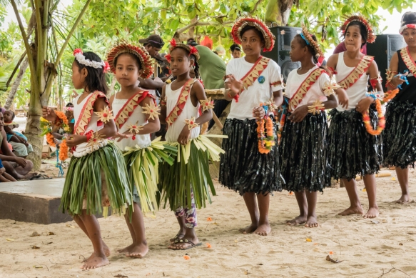 The girls who danced to the rhythmic (hand) drumming of the adults on a raised platform, nearby, spanned a wide age range, Titiana Village, Ghizo Island, Solomon Islands