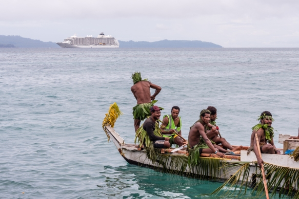 The island_s ceremonial canoe juxtaposed with our ship at anchor, Baluan Island, Papua New Guinea