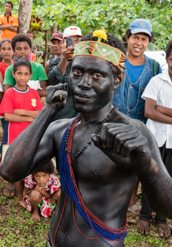 The islanders were enjoying watching their warriors welcome us, Baluan Island, Papua New Guinea