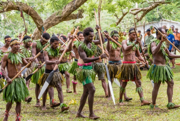 The men canoeists then put on a dance with their canoe paddles, Baluan Island, Papua New Guinea