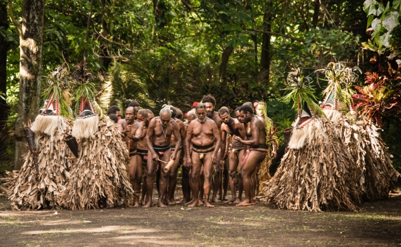 the-men-half-in-masked-costumes-and-the-other-half-nearly-naked-except-for-their-penis-sheaths-called-nambas-in-bislama-have-begun-the-rom-dance-ambrym-island-vanuatu