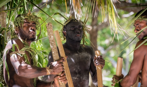 The rhythmic music for the Ceremonial Dance on Loh Island, Torres Islands, Vanuatu, was provided by about a half dozen men who performed in the center of the outdoor performance area und