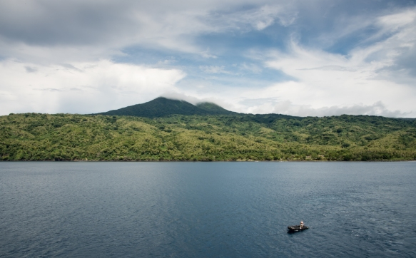 the-summit-at-the-center-of-ambrym-island-vanuatu-is-the-home-of-the-active-volcano-and-its-two-craters-some-smoke-is-visible-coming-out-of-them