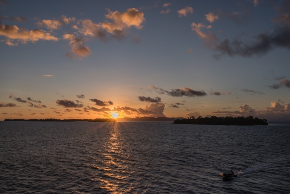 The sun setting over the northern islands of Marovo Lagoon, Solomon Islands