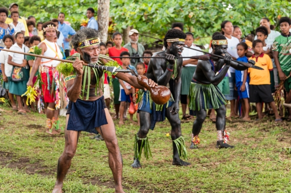 "The warriors came down to the shore to greet us with a ""war dance"", Baluan Island, Papua New Guinea"