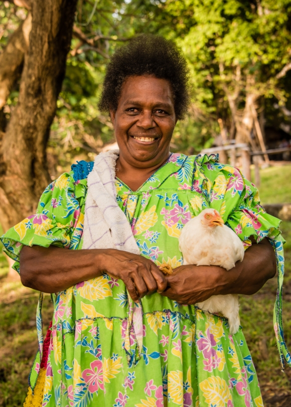 this-local-woman-was-very-friendly-and-loved-posing-for-portraits-in-her-yard-with-her-chicken-ambrym-island-vanuatu