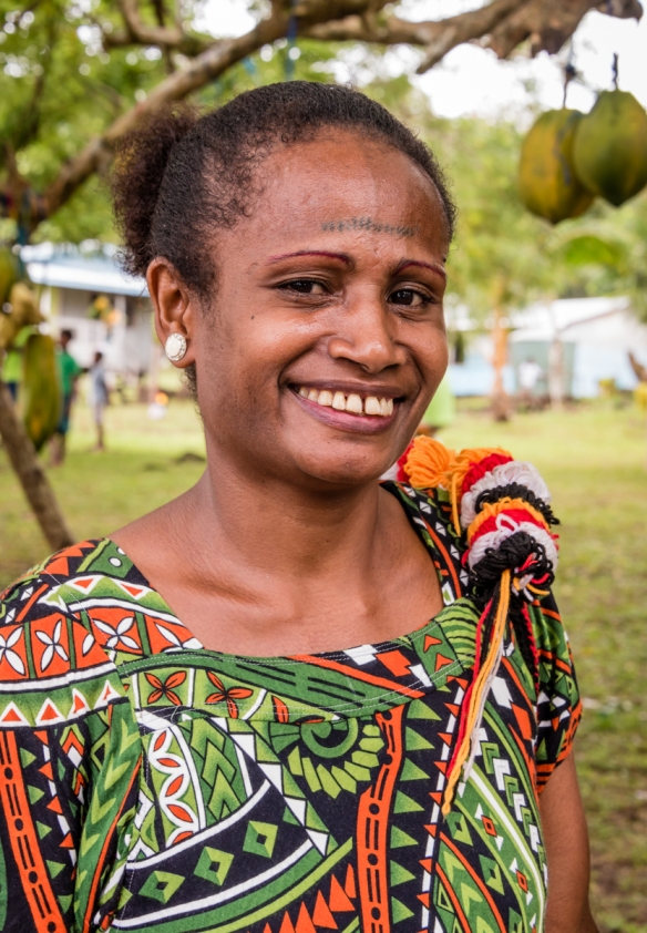This woman came over from Manus Island, the Provincial capital, to watch the ceremonies, Baluan Island, Papua New Guinea; her forehead tattoo is the marking that women on the island of M