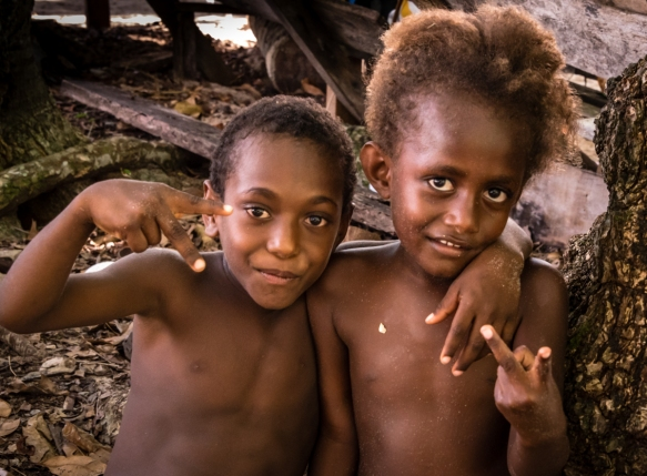 "Two young boys on Mavea Island, Vanuatu, happy on the beach after watching the ""Water Women_s performance"