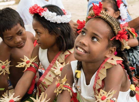 Young dancers relaxing before their performance for us in Titiana Village, Ghizo Island, Solomon Islands