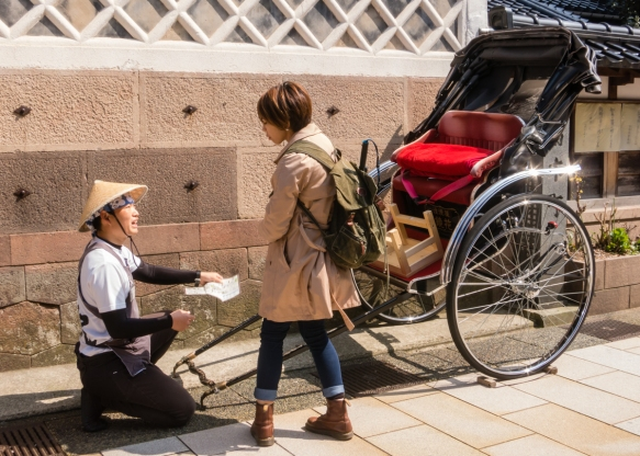"A rickshaw ""driver"" negotiates with a prospective passenger in the Eastern Geisha District (Higashi-chaya-gai), Kanazawa, Honshu Island, Japan"