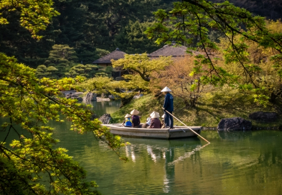 A small group of ladies out for a boat ride on Nanko pond in the South Garden of Ritsurin Garden, Takamatsu, Kagawa, Japan