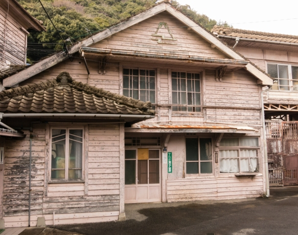 A traditional older home in Arita, Kyushu, Japan, built of wood, rather than stone, for better survival in an earthquake; the symbol represents Mt. Fuji and rivers