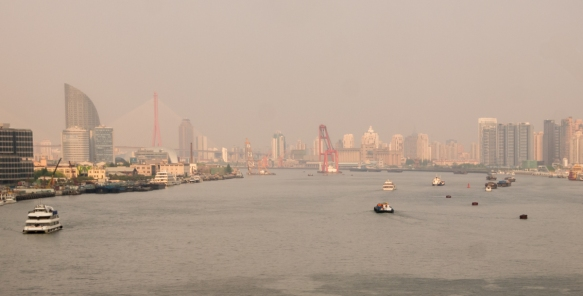 A view of the Huangpu River looking towards the east, where it meets the sea, Shanghai, China; the Bund is about 1.5 kilometers -1 mile in the opposite direction