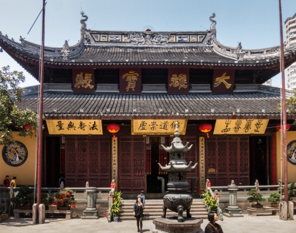 Built in 1882, the Jade Buddha Temple was built in the style of the Song Dynasty with symmetrical halls and courtyards, upturned eaves, and bright yellow walls, Shanghai, China