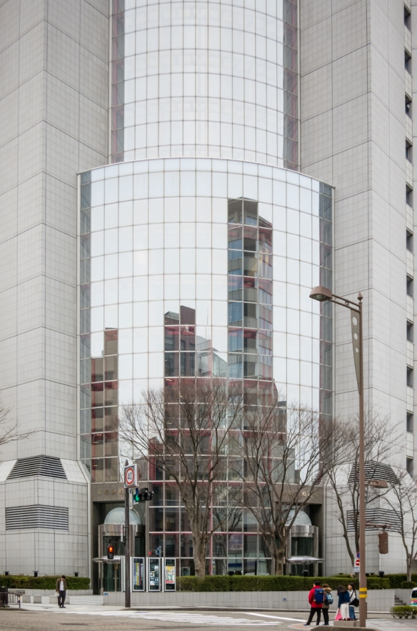 Contemporary building and reflection, downtown Kanazawa, Honshu Island, Japan