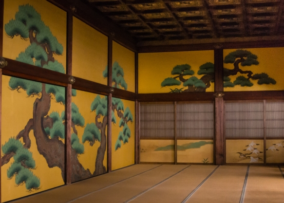 Elaborate, gilded paintings on the screen walls within Ninomaru-goten Palace in Nijo-jo Castle, Kyoto, Japan; this room was the waiting room for daimyo lords and foreign dignitaries wait