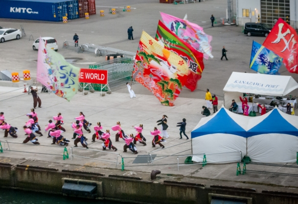 Local dancers and flag bearers gave us a rousing sendoff performance for the last half-hour at the pier – great enthusiasm and exciting music, Kanazawa, Honshu Island, Japan; the warm