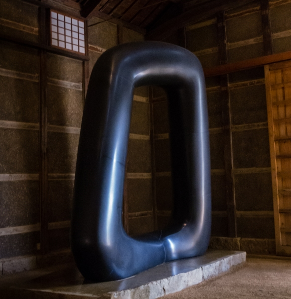"One of Noguchi_s largest and most famous sculptures, ""Energy Void,"" carved out of Swedish black granite is in the shed within the outdoor sculpture garden at the Isamu Noguchi Gard"