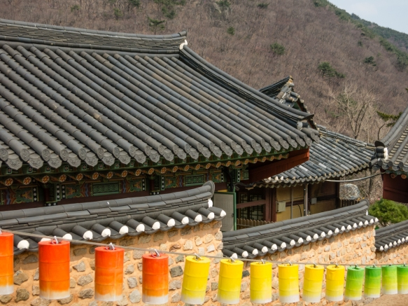 Roof lines and lanterns of Beomeosa Temple set against Mt. Geumjeongsan, Busan, South Korea