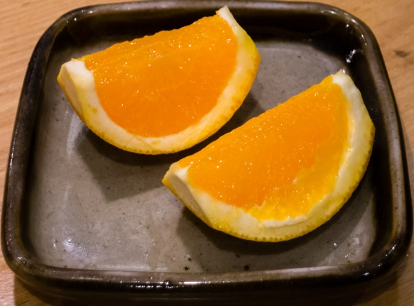 Simplicity itself, but dessert was sweet and refreshing – orange slices -- at Inakaya (Roppongi East), Tokyo, Japan