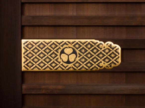 The family crest of the Tokugawa Shogunate was on each door in Nijo-jo Castle, Kyoto, Japan; note that after rule of Japan was returned to the Emperor and the Castle became an Imperial r