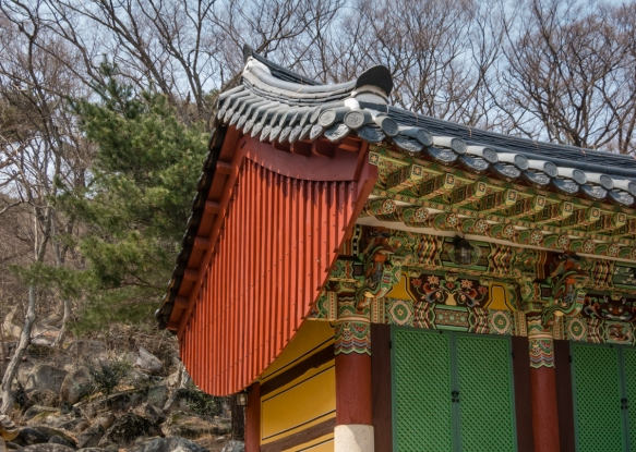 The roof and side of one of the seven royal palace wings Beomeosa Temple, Mt. Geumjeongsan, Busan, South Korea
