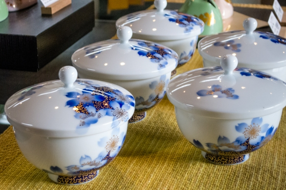 "These covered bowls showcase the white purity of Fukagawa-Seiji ""almost transparent white porcelains"" with designs using the ""Fukagawa Blue"" pigments, Fukagawa-Seiji store, Arita"