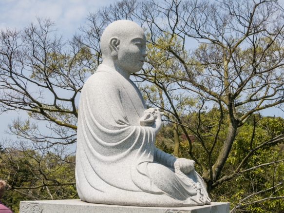 This Buddha guards the entrance to the vista point overlooking the Takamatsu region beyond Yashimaji Temple #84 on the 88 Temple Pilgrimage, Takamatsu, Shikoku Island, Japan