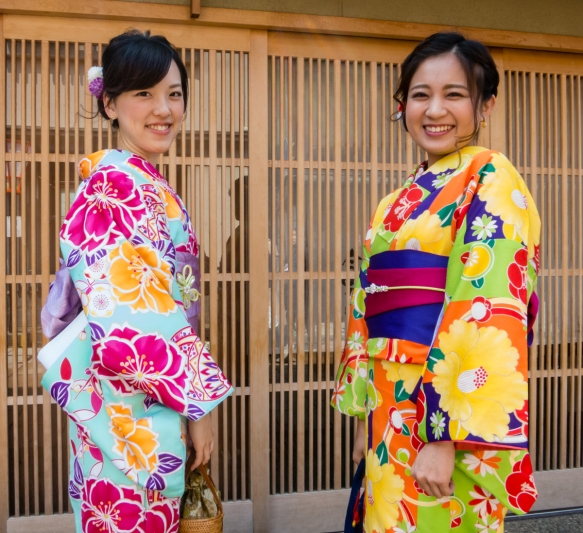 Two young Japanese tourist girls who had rented (for the day) traditional kimonos (modern fabrics) walking through the Eastern Geisha District (Higashi-chaya-gai), Kanazawa, Honshu Islan