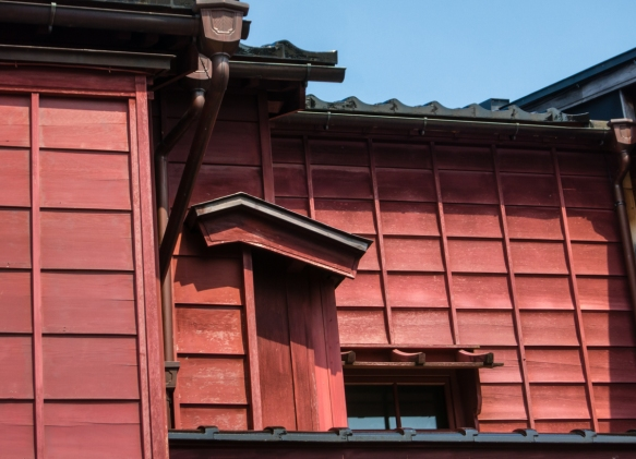 While most of the restored, typical wood-slatted teahouses today are not painted, this one was painted in a distinctive red color, Eastern Geisha District (Higashi-chaya-gai), Kanazawa,