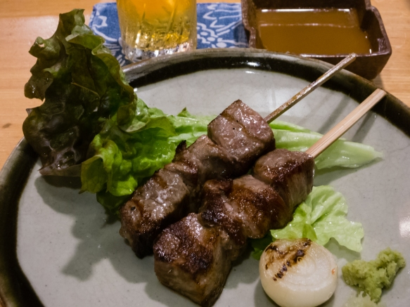Wonderful wagyu, succulent cubes of marbled Omi beef from Shiga, skewered, grilled and served with a dip of shoyu, garlic and fresh-grated wasabi root, Inakaya (Roppongi East), Tokyo, Ja
