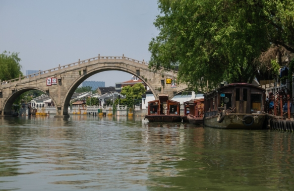 A classical bridge over a wide lake along the Grand Canal, Suzhou, China