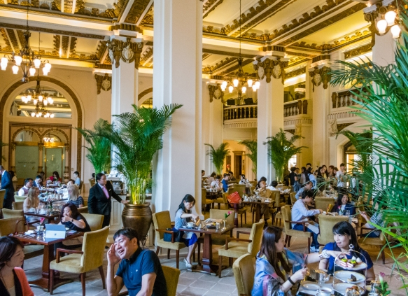 """A formal British-style afternoon """"high"""" tea is served in the lobby of the Peninsula Hotel, Hong Kong, S.A.R., People_s Republic of China"""
