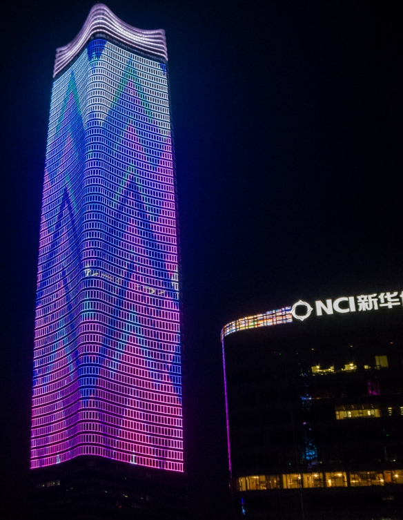 A geometric design in lights on the nearby skyscraper which we could watch from our apartment_s balcony on our ship, docked at the Shanghai Port International Passenger Terminal, Shang
