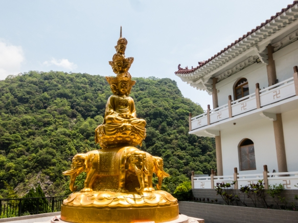 A golden Buddha seated upon four elephants outside the outbuilding of the Buddhist Temple in Taroko National Park, Hualien, Taiwan