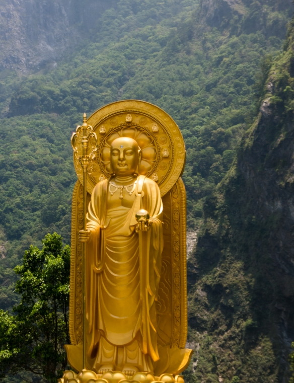 A Golden Buddha with the mountains of Taroko National Park as a backdrop, Hualien, Taiwan