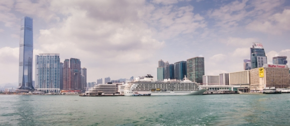 A panorama of our ship docked at Ocean Terminal in Kowloon, with the new International Commerce Center towering over us on the left and the Star (Ferry) House office building (with some