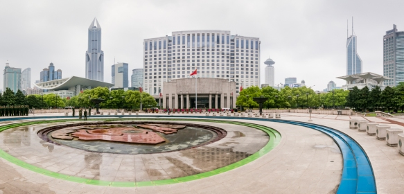 A panorama of People_s Square, Shanghai, China, looking north with the Shanghai Grand Theater on the left, the refurbished Shanghai Municipal Government Mansion in the center, and the