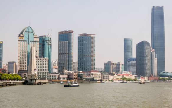 A view of the stretch of the shoreline along the Huangpu River (north of the Bund) beyond the Monument to the People's Heroes on the left to the Shanghai Port International Passenger Ter