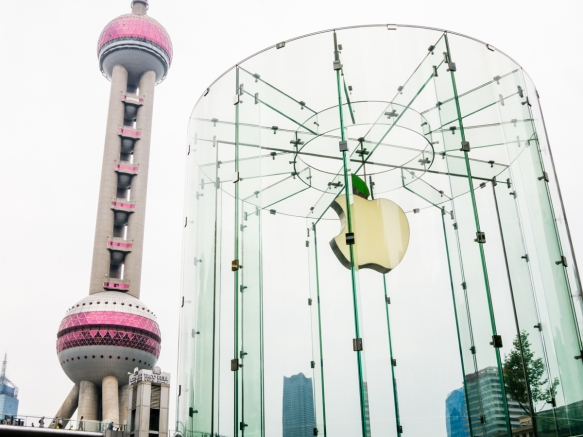 Architectural icons of the late 20th and early 21st centuries- the Oriental Pearl Radio & TV Tower and the Pudong Apple retail store, Pudong district, Shanghai, China